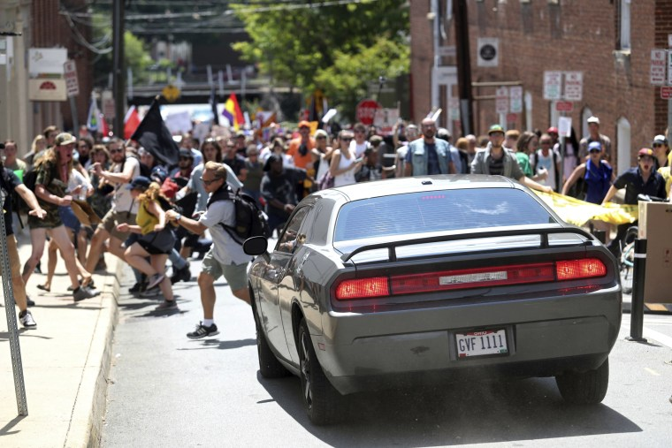 Image: A vehicle drives into a group of protesters demonstrating against a white nationalist rally in Charlottesville, Virginia, Aug. 12, 2017.