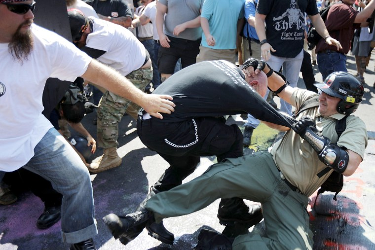 """Image: Protesters clash with counter-protesters as they enter Lee Park during the \""""Unite the Right\"""" rally in Charlottesville"""