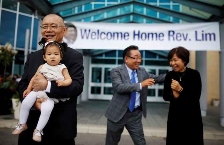 Pastor Hyeon Soo Lim holds his granddaughter in front of his wife Geum Young Lim as he leaves the Light Presbyterian Church in Mississauga, Ontario, Canada, August 13, 2017.