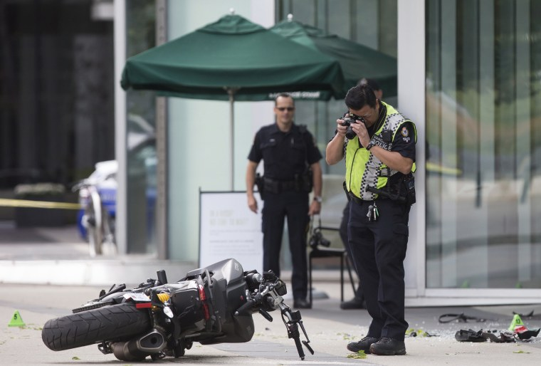 """Image: A police officer photographs a motorcycle after a female stunt driver working on the movie """"Deadpool 2"""" died after a crash on set"""