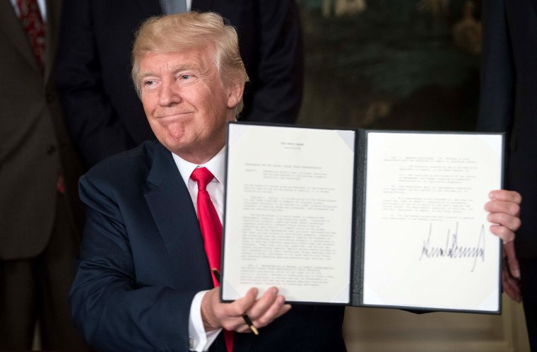 Image: Trump Finishes Signing a Memorandum
