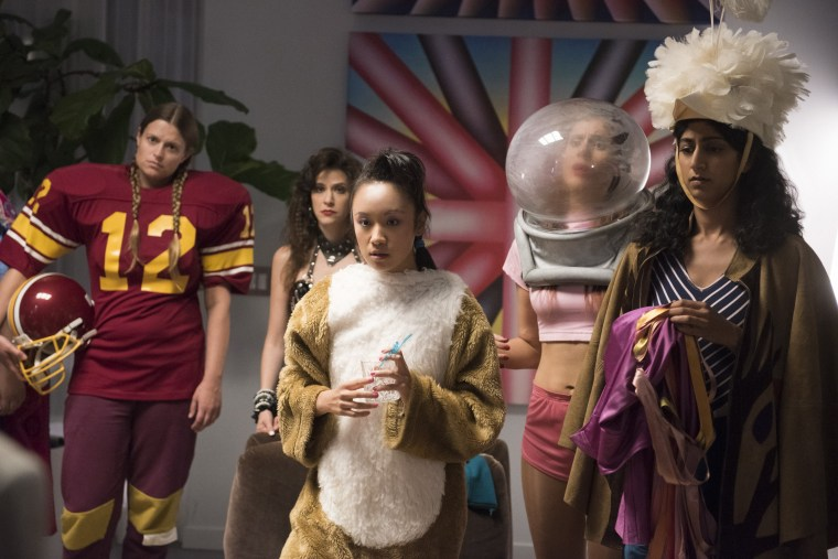 "Image: Ellen Wong (center) plays Jenny Chey on Netflix's ""GLOW"""