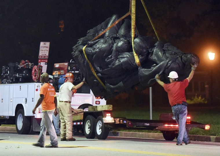 Image: Workers remove a monument dedicated to the Confederate Women of Maryland