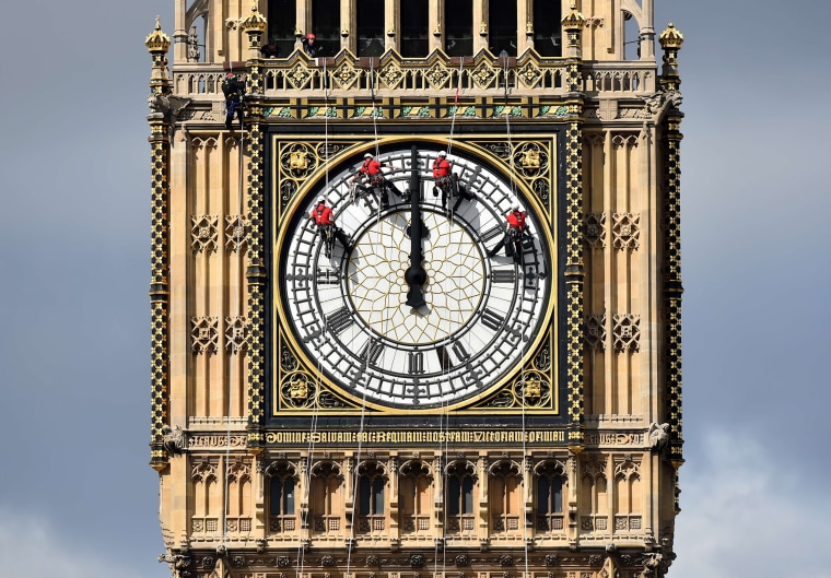 Image: Technicians clean one of the faces of Big Ben