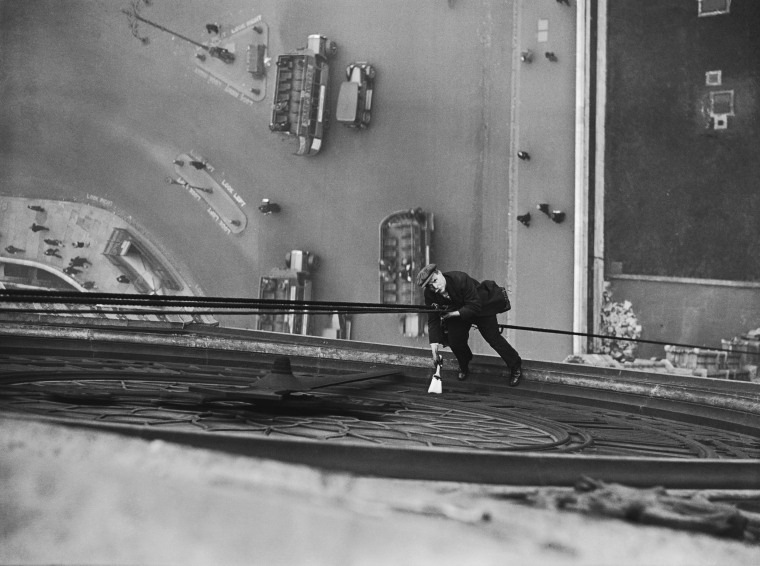 Image: A worker cleans the face of Big Ben