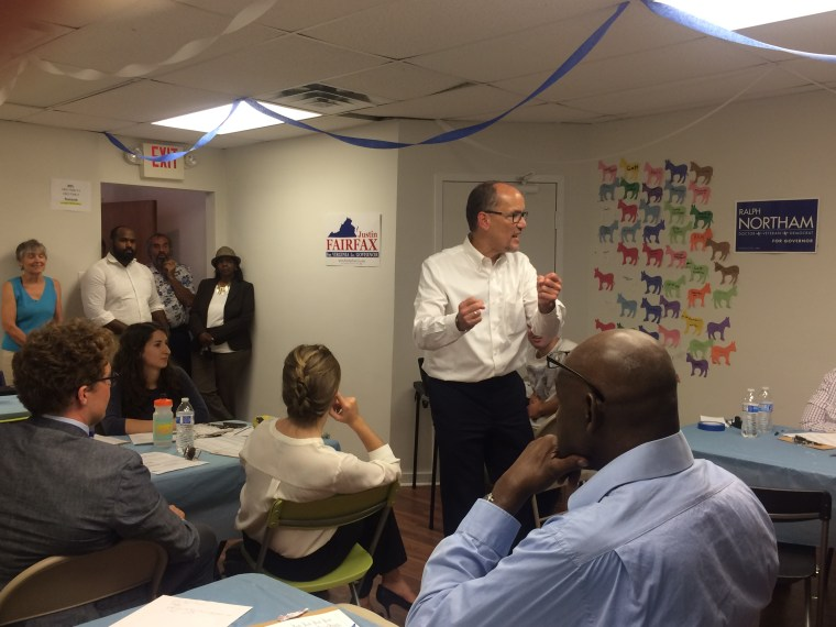 Democratic National Committee Chairman Tom Perez revs up phone bankers in Richmond, Va., on Aug. 10.