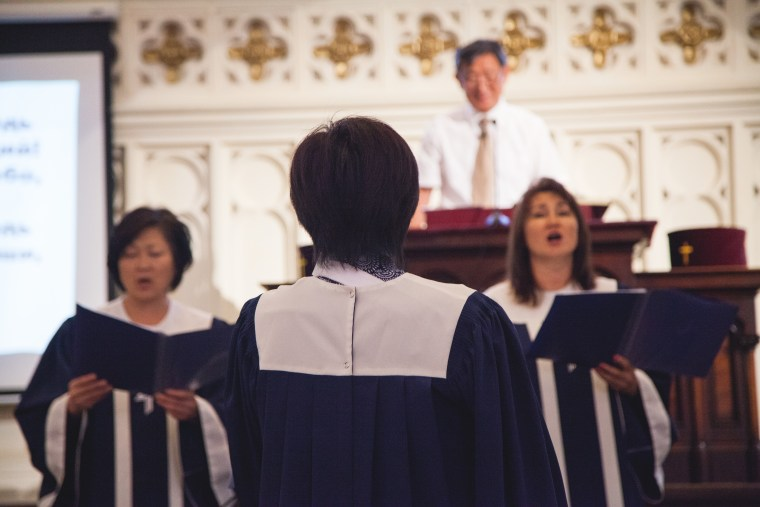 A woman sings during a Russian-language sermon led by the Rev. Leonid Kim in Brooklyn, New York.