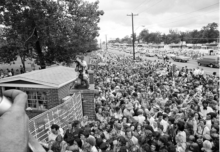 Hundreds of people wait outside Graceland mansion before the gates are opened for the public to view the body on Aug. 17.