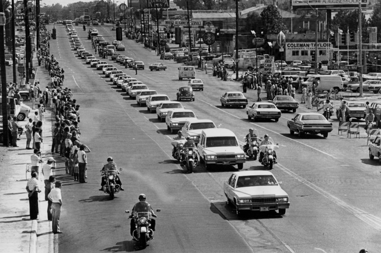 The hearse carrying Elvis drives along Elvis Presley Boulevard on the way to Forest Hills Cemetery in Memphis on Aug. 19.
