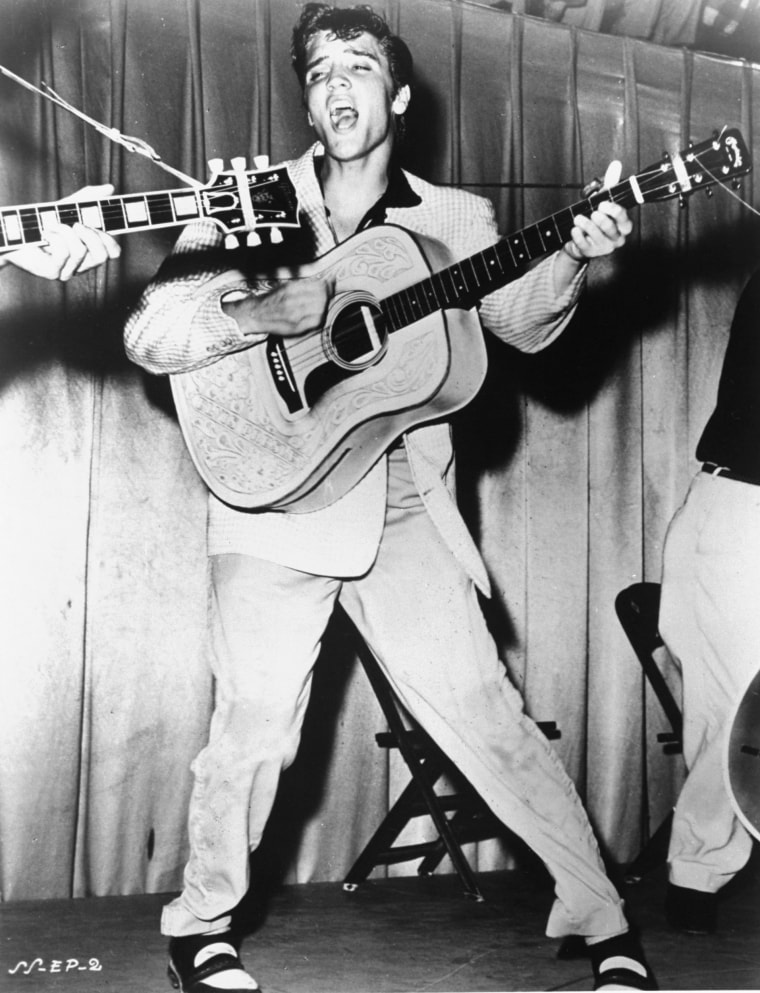 Elvis Presley performs in 1956 in a photo that was used for his first RCA Victor album cover.