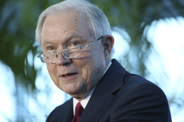 Image: Sessions speaks during a news conference