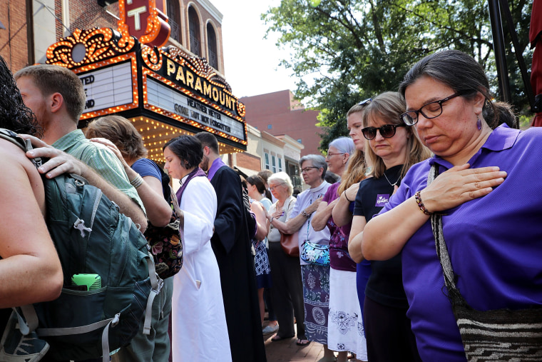 Image: Clergy observe a moment of silence during the memorial service for Heather Heyer