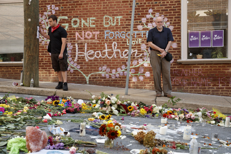 Image: Jason Charter of Washington, left, stands at the site where Heather Heyer was killed
