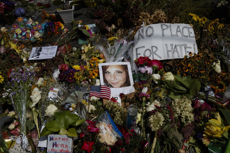 Image: A photo of Heather Heyer, who was killed during a white nationalist rally, sits on the ground at a memorial