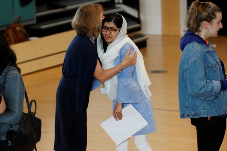 Image: Malala Yousefzai is congratulated after collecting her exam results at Edgbaston High School for Girls in Birmingham, England.