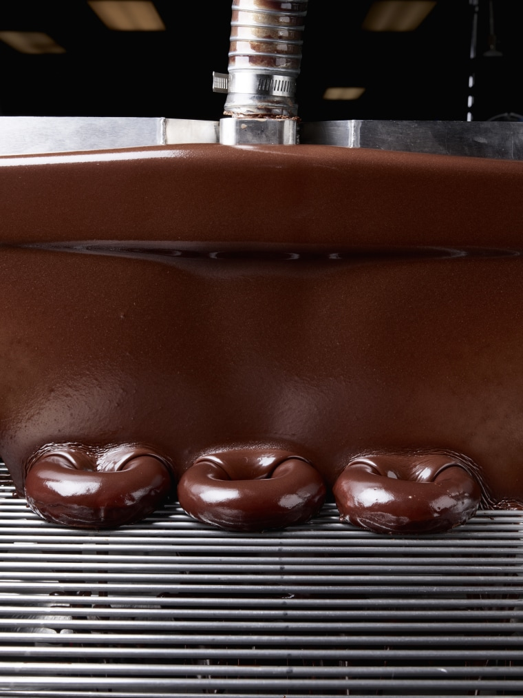 Krispy Kreme's eclipse donut isn't just coated with chocolate, it is smothered in it.