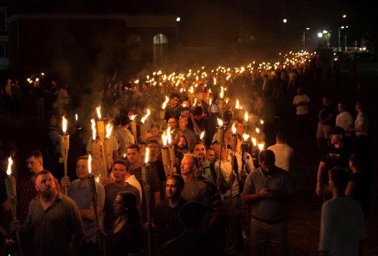 Image: White nationalists carry torches on the grounds of the University of Virginia, on the eve of a planned Unite The Right rally in Charlottesville