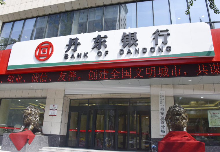 Image: This photo taken July 5, 2017 shows the Bank of Dandong, a Chinese bank accused of laundering money for North Korea.