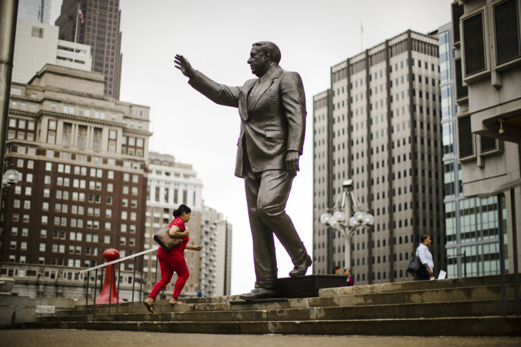 A statue of the late Philadelphia Mayor Frank Rizzo, who also served as the city's police commissioner, outside the Municipal Services Building in Philadelphia, on Aug. 15.