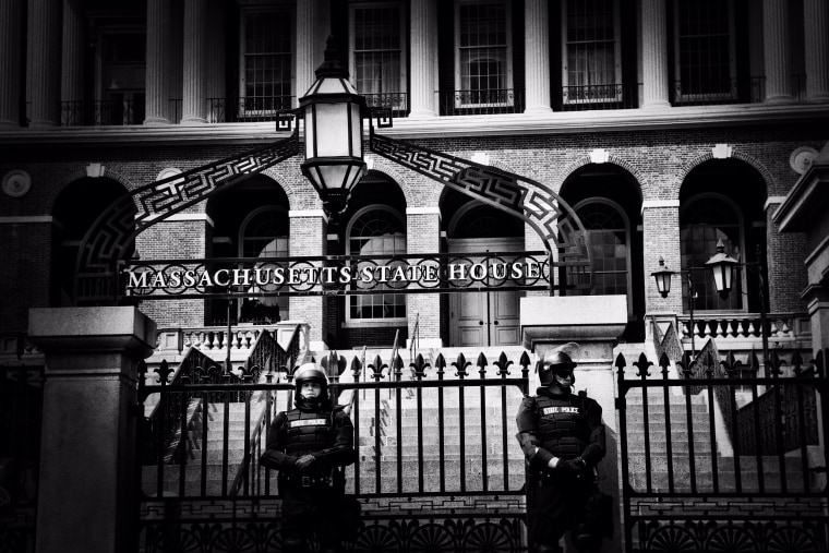 Image: Police officers stand guard over the Massachusetts State House.