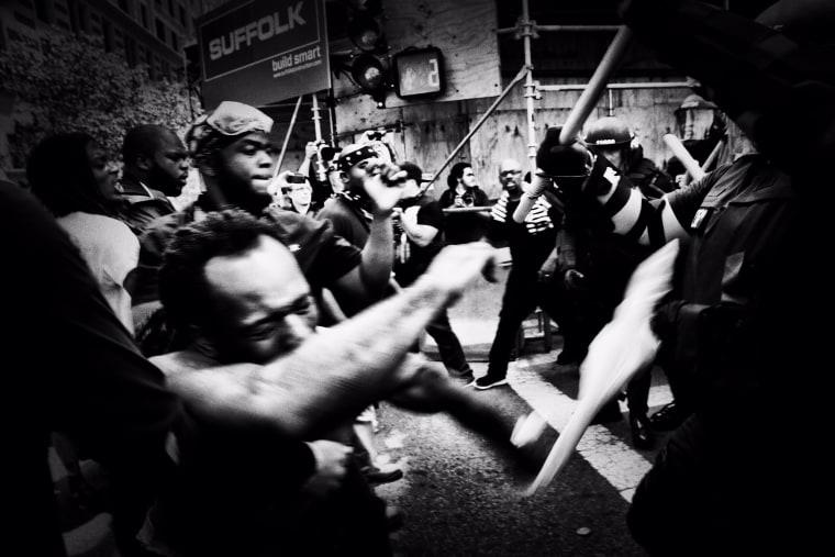 Image: Demonstrators and police clash in Boston.