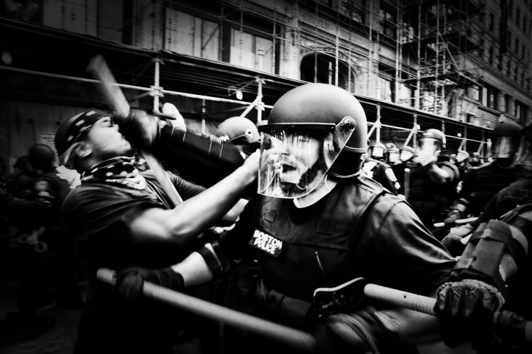 Image: Police push back protesters as the 'Free Speech Rally' attendees are ushered out of the area.
