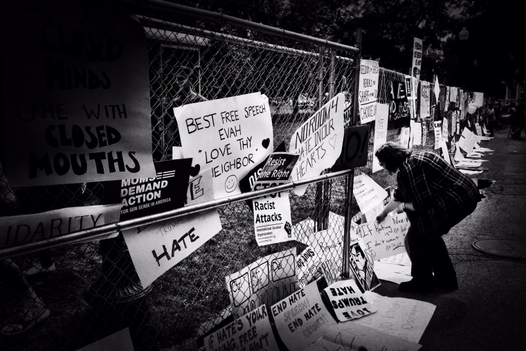 Image: Protesters leave their signs along the gate as the demonstrations come to a close.