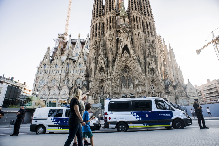 Image: Guards watch over La Sagrada Familia in Barcelona.