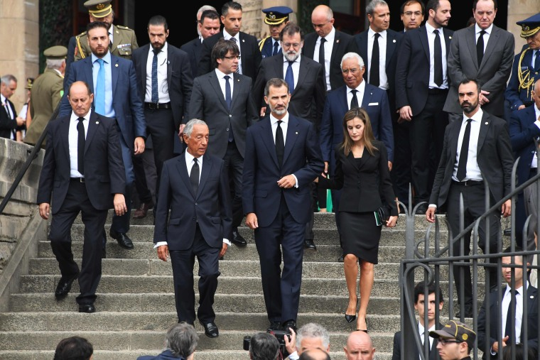 Image: Spain's King Felipe VI, Spain's Queen Letizia and Portugal's President Marcelo Rebelo de Sousa leave a mass to commemorate victims.