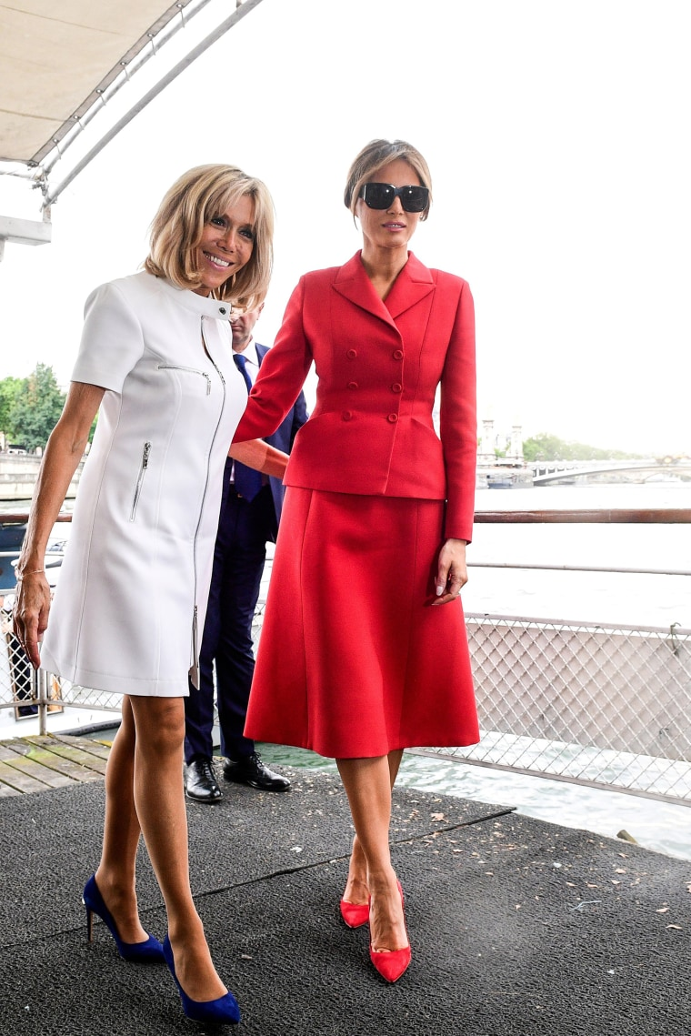 Image: FILE PHOTO - US First Lady Melania Trump and Brigitte Macron, wife of French President Macron, leave after a boat trip down the River Seine in Paris