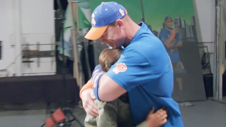 John Cena reacts to being surprised by young fan Tyler Schweer.