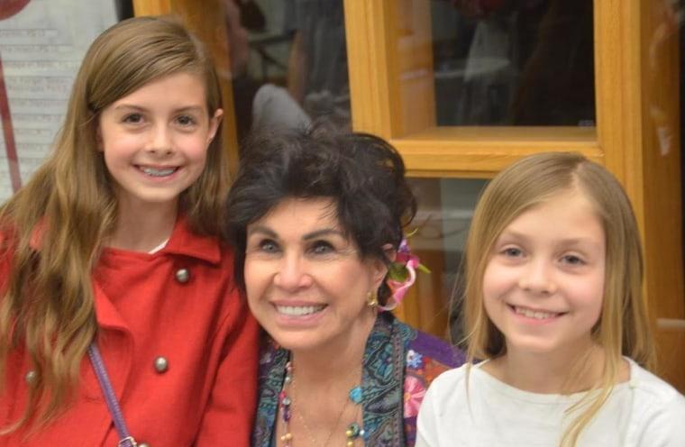 Dorinda Makanaonalani Nicholson with two of her granddaughters.