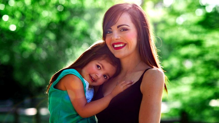 Hayley Booth, pictured with daughter Rachel, said she hopes to inspire other parents trying to co-parent peacefully after divorce.