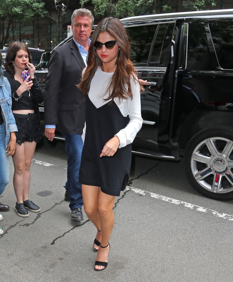 Selena Gomez steps out in a dress and flashes her legs while doing radio promotion in New York City.