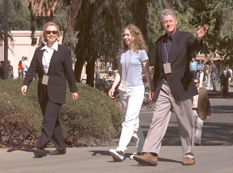 US President Bill Clinton (R) walks with US First