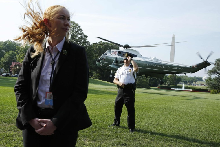 Image: U.S. Secret Service agents standing guard as Marine One helicopter with President Donald Trump on board