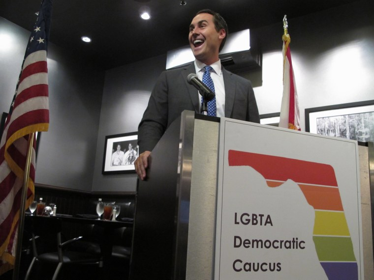 Businessman and gubernatorial candidate Chris King talks to a group of gay  and lesbian Democrats in Tallahassee, Fla., on Saturday, Aug. 19, 2017.