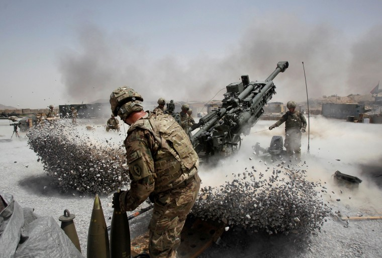 Image: FILE PHOTO: U.S. Army soldiers from the 2nd Platoon, B battery 2-8 field artillery, fire a howitzer artillery piece at Seprwan Ghar forward fire base in Panjwai district