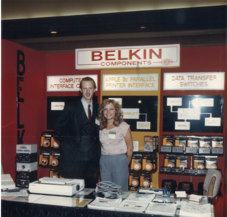 Belkin founder Chet Pipkin (left) at Belkin booth during Comdex Show (CES), 1984.