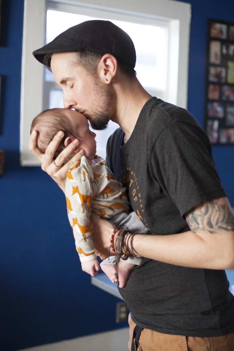 Trystan Reese, a transgender man, and his biological newborn, Leo.