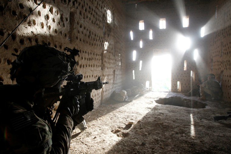 Image: FILE PHOTO: U.S. soldier points his rifle after coming under fire in Zharay district in Kandahar province, southern Afghanistan