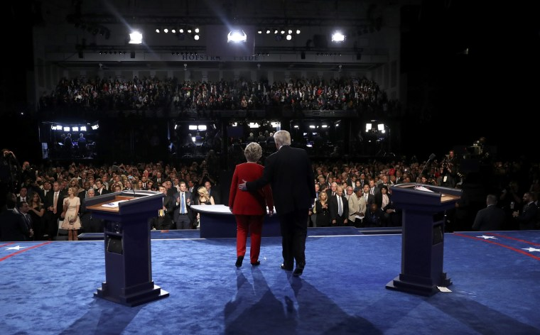 Image: Republican U.S. presidential nominee Donald Trump stands with Democratic U.S. presidential nominee Hillary Clinton at the conclusion of their first presidential debate at Hofstra University in Hempstead