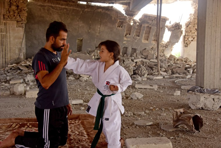 Image: Noor Setout practices karate with her father, Wassim.