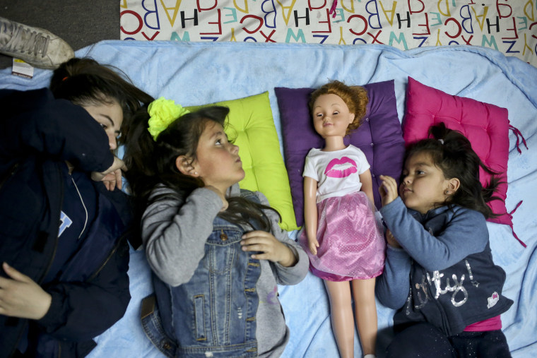 Image: Transgender girls Selenna, second from left, and Mathilda, right, play with a doll.