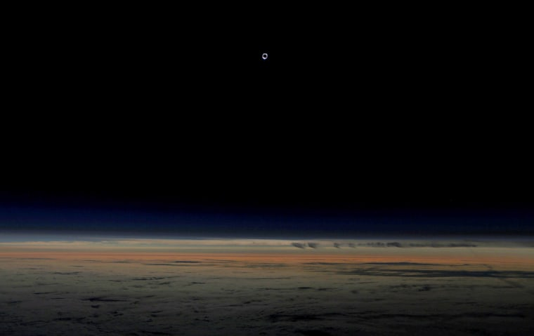 Image: The sun is obscured by the moon during a solar eclipse as seen from an Alaska Airlines commercial jet at 40,000 feet above the Pacific Ocean off the coast of Depoe Bay, Oregon, U.S.