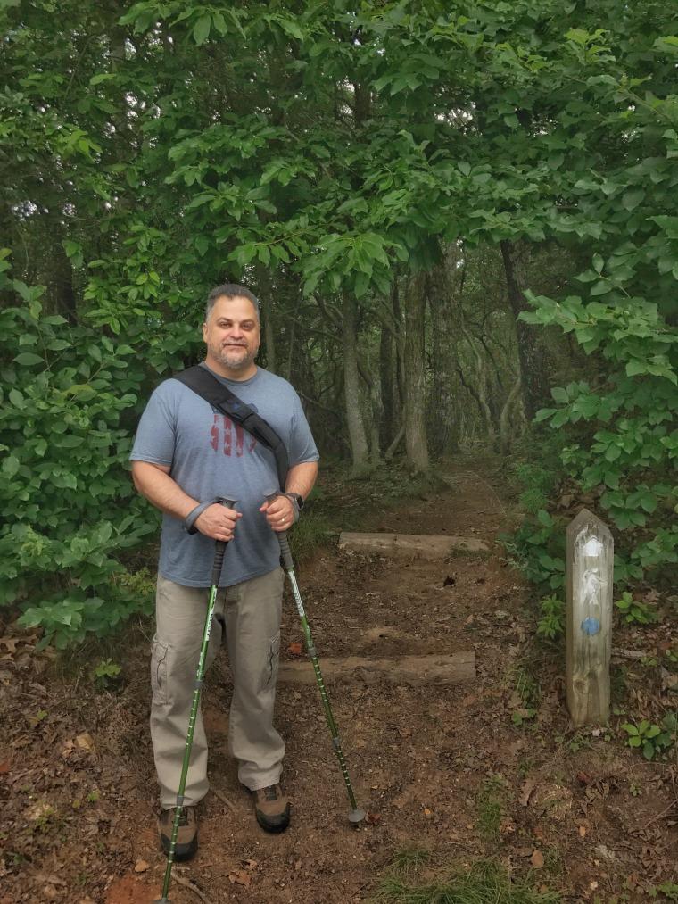Daniel J. Green is getting fit by hiking.