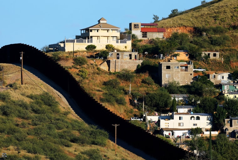 Image: FILE PHOTO:    File photo of buildings in Nogales, Mexico separated by a border fence from Nogales, Arizona