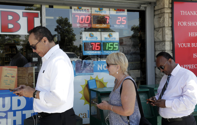 Image: People Purchase Lottery Tickets for Powerball which is at 700 million US dollars