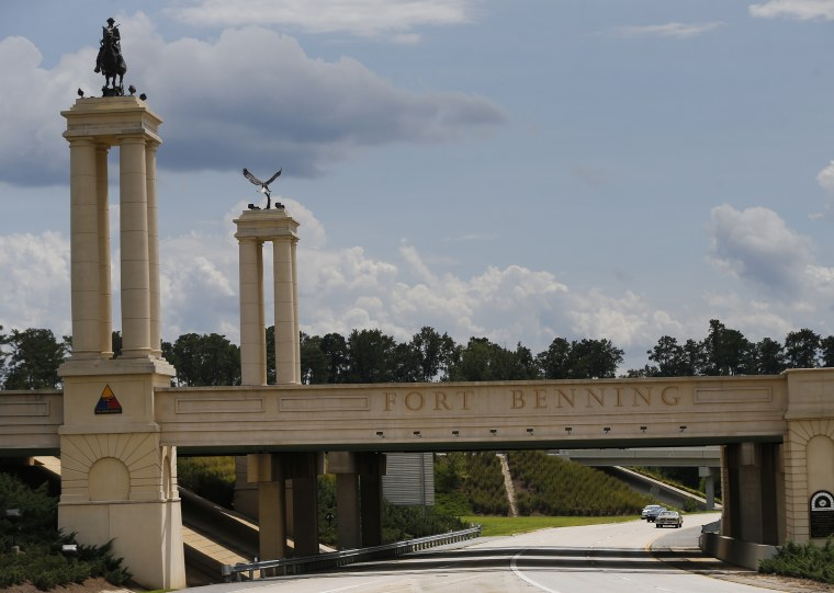 Image: A bridge over I-185 marks the entrance to the U.S. Army's Fort Benning in Columbus, Georgia