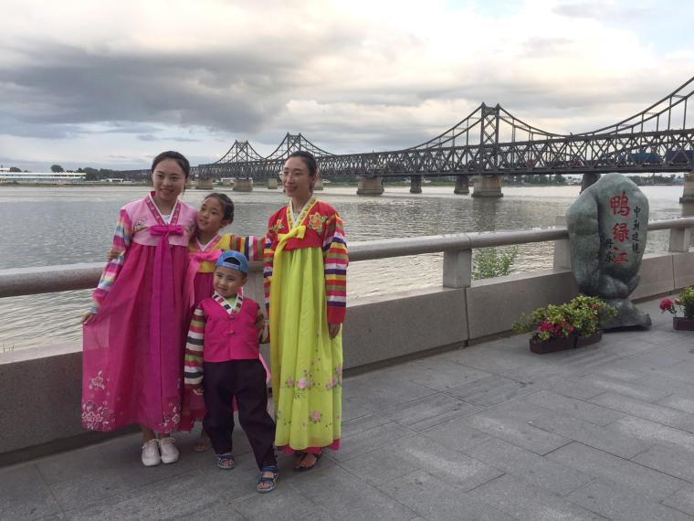 Image: Visitors pose in Dandong